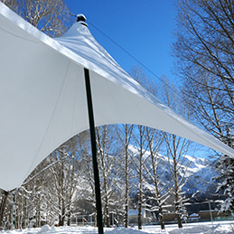 Snow covered tensile roof | Serge Ferrari Precontraint 1202